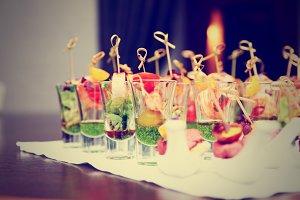 Various snacks in shot glasses