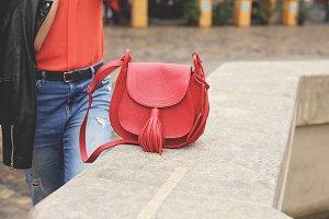 Woman with red handbag