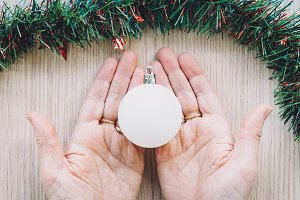 Christmas composition on woman hands