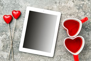 Tablet PC with red hearts