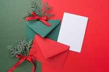 Red and green envelopes on christmas holiday background. Flat lay.