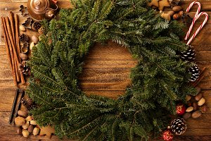 Christmas pine wreath with spices and candy cones