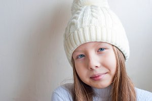 Little girl in white knitted hat