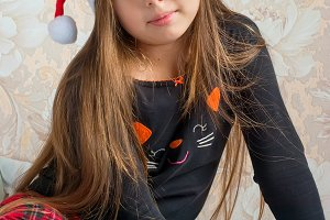 Little girl in pajamas on Christmas