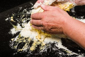 Baker forming flour to pasta