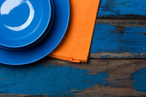Colorful blue orange background with empty plates