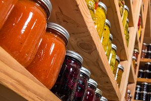 Tomato sauce on pantry shelf