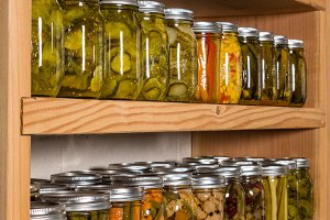 Pickles canned on pantry shelf