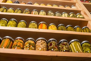 Pickles and jars on pantry shelf
