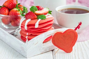 Stack of red velvet pancakes with yogurt and strawberry on on wooden tray, horizontal