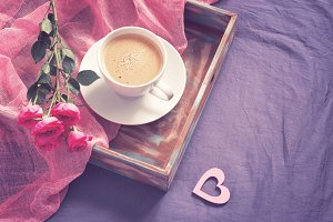 tray with cup of coffee and roses