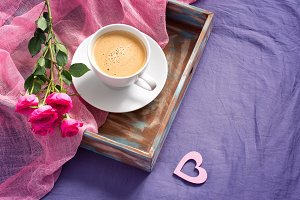 tray with cup of coffee and roses.