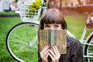 Funny woman with book