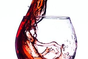 Wine splashing in glass