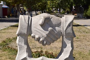 Sculpture handshake. Symbol of friendship and cooperation