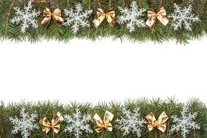 Christmas frame made of fir branches decorated with golden bows and snowflakes isolated on white background