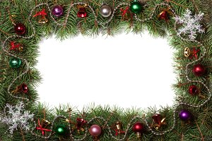 Christmas frame made of fir branches decorated with bells and balls isolated on white background