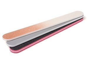 Three nail file with a different abrasive isolated on white background