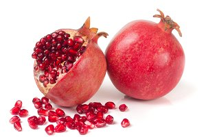 two pomegranate isolated on a white background