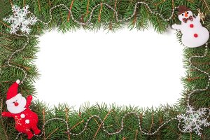 Christmas frame made of fir branches decorated with Santa Claus snowman and beads isolated on white background