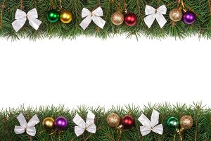 Christmas frame made of fir branches decorated with balls and silver bows isolated on white background