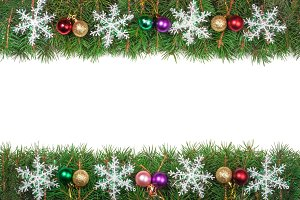 Christmas frame made of fir branches decorated with colored balls and snowflakes isolated on white background