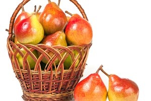pears in a wicker basket isolated on white background