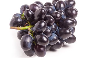 Bunch of blue grapes isolated on white background