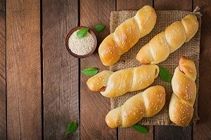 Sausage in the dough with sesame