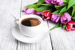 Cup of coffee with tulips