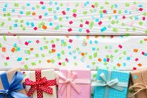 gift boxes on background of confetti