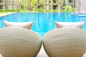 Relaxing rattan chairs with pillows