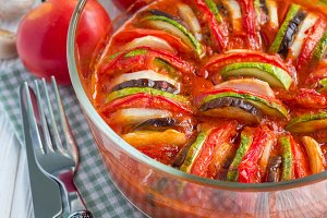 Homemade vegetable ratatouille in glass dish, cooked in oven, closeup
