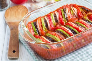 Homemade vegetable ratatouille in glass dish, cooked in oven, horizontal