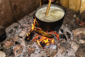 Cooking fires in a black iron pot