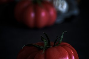 Red tomatoes with black background