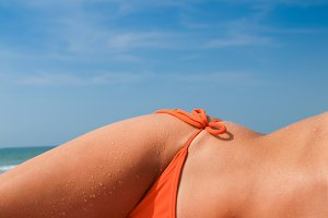blue sky tanned female body