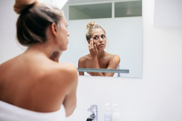 Woman applying cosmetic cream
