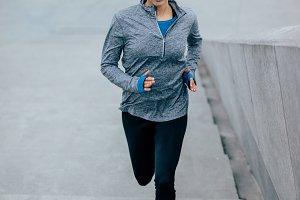Fitness woman doing running exercise