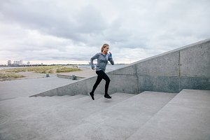 Fit young woman running