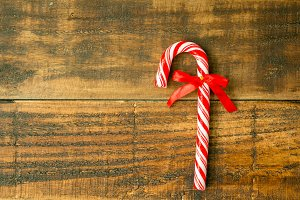 Candy canes on wooden background