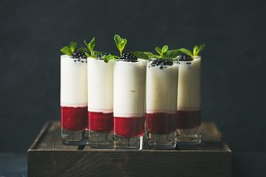 Dessert in glass with blackberries