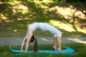 woman practices yoga in nature