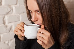 woman in cafe drinking