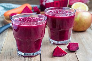 Healthy detox beetroot, carrot, apple and lemon juice smoothie, horizontal