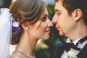 Bride looks with love at groom