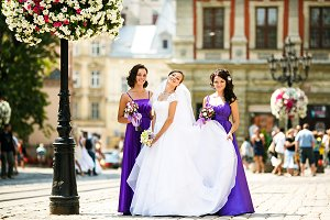 Bridesmaids and bride on a street