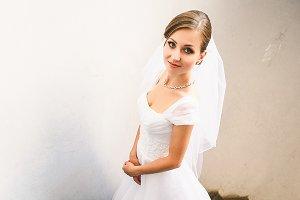 Bride looks shy posing