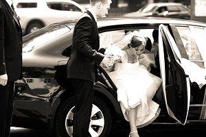 Groomsman helps bride