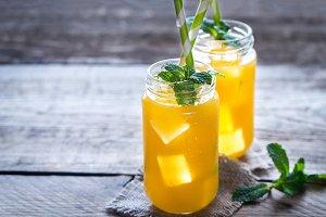 Glass jars of mango juice